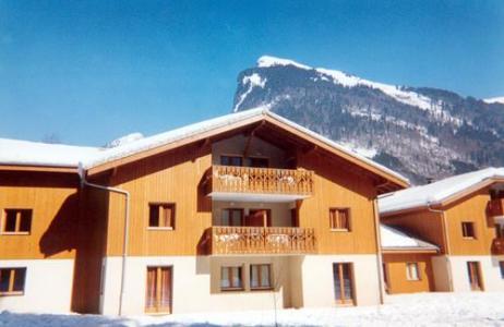 Location au ski Residence Le Domaine Du Grand Tetras - Samoëns - Extérieur hiver