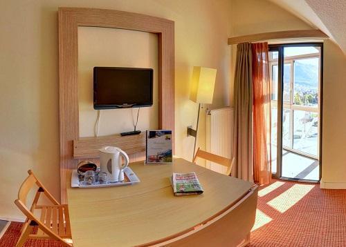 Skiverleih Hôtel Suite Home Briançon - Serre Chevalier - Wohnzimmer