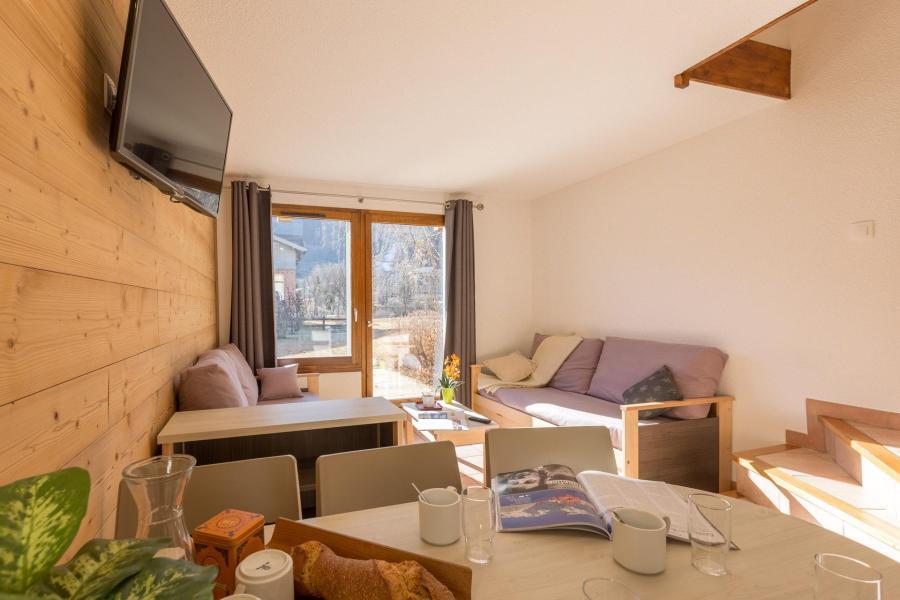 Location au ski Les Chalets du Jardin Alpin - Serre Chevalier - Banquette-lit tiroir