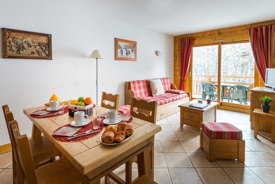 Location au ski Résidence Lagrange le Hameau du Rocher Blanc - Serre Chevalier - Coin repas