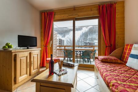 Location au ski Résidence Lagrange le Hameau du Rocher Blanc - Serre Chevalier - Coin séjour