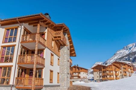 Location au ski Les Balcons De Val Cenis Village - Val Cenis - Extérieur hiver