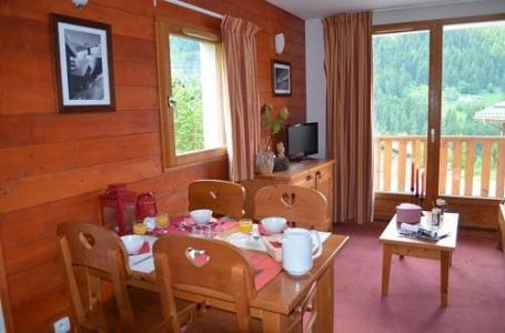 Location au ski Residence Les Chalets De La Ramoure - Valfréjus - Coin repas