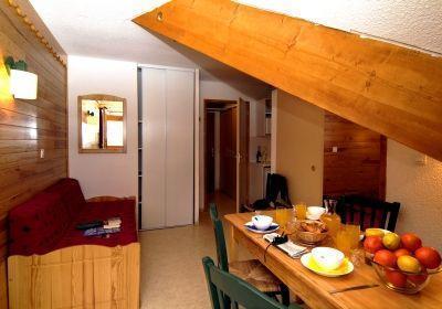 Location au ski Residence L'ecrin Des Neiges - Valmeinier - Coin repas