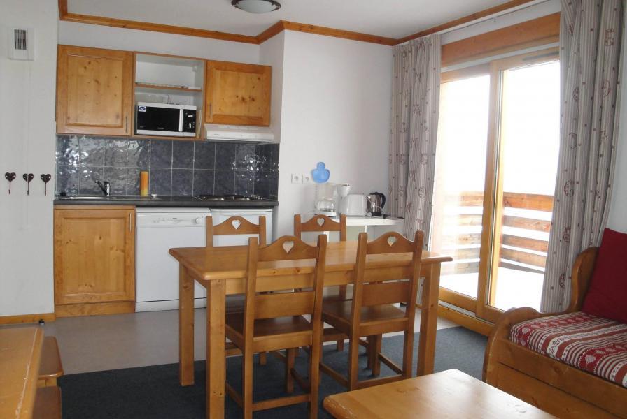 Rent in ski resort Résidence les Valmonts de Vaujany - Vaujany - Dining area